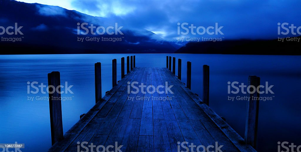 Tranquil lake with jetty royalty-free stock photo