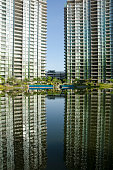 Tranquil lake with reflection of building and sky