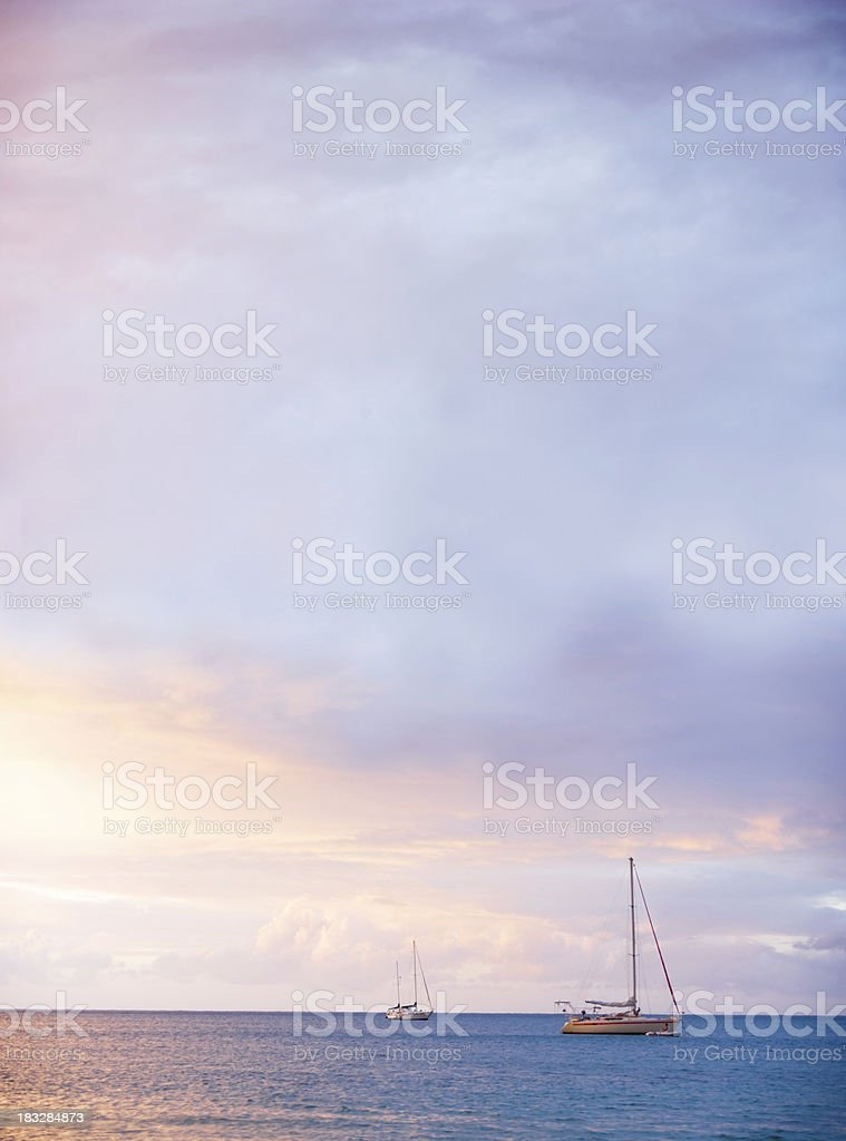 tranquil ocean and sky scene with yachts sailing royalty-free stock photo