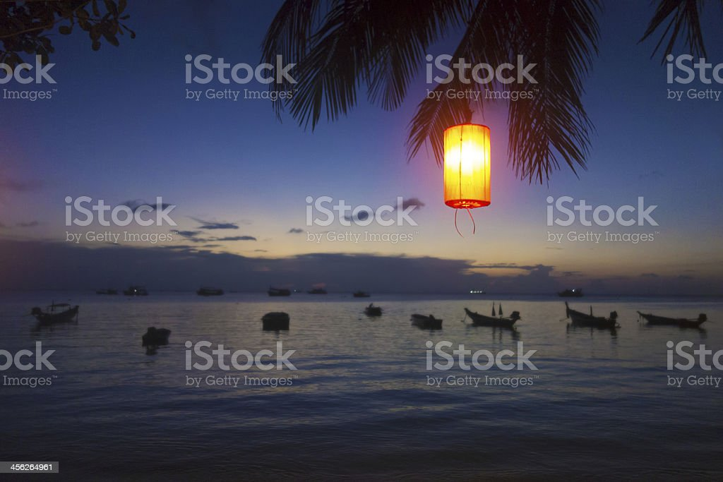 Tranquil peaceful scene, traditional boats at sunset on the sea royalty-free stock photo