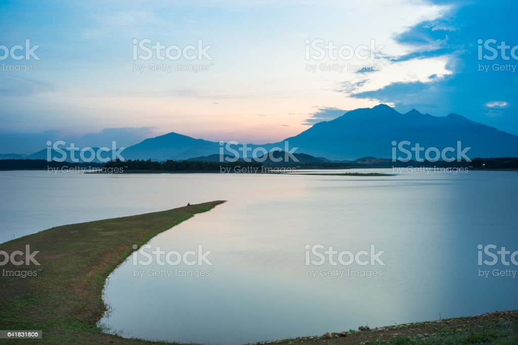 Tranquil scene of lake view with foreland at twilight stock photo