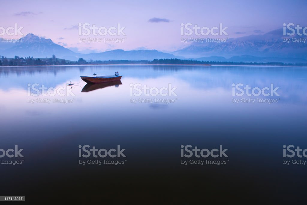 tranquil scene with boat at lake hopfensee royalty-free stock photo