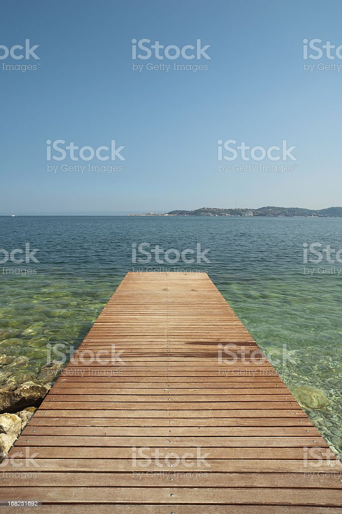 Tranquil scene with jetty at the beach stock photo