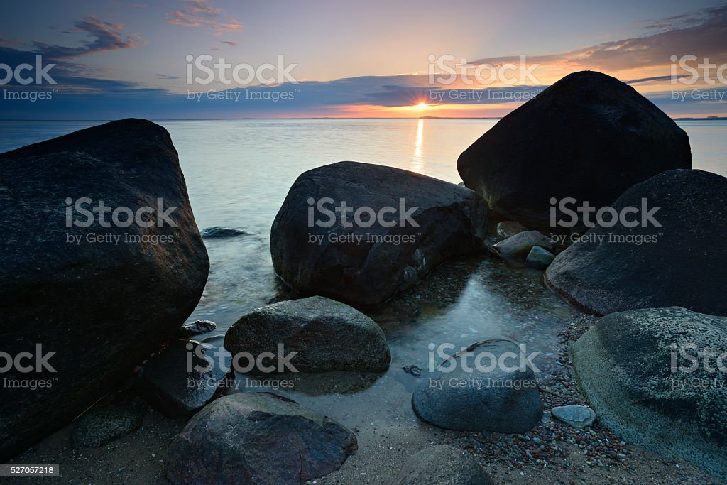 Tranquil Seascape with Huge Boulders at Sunset, Rugen Island, Germany stock photo