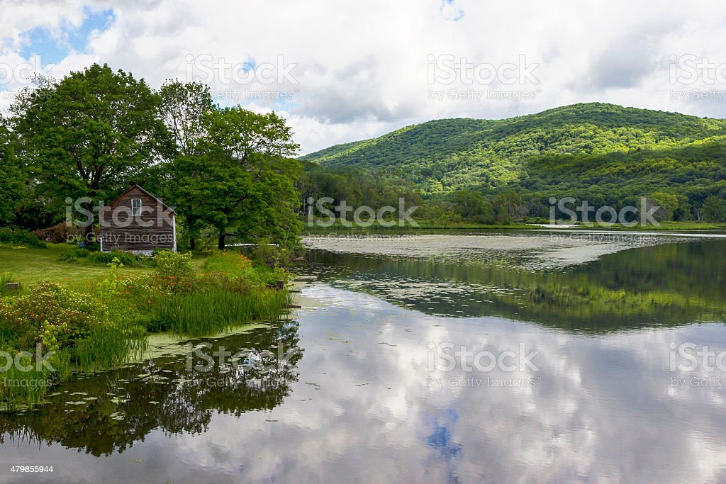 Tranquil Sky-Reflecting Lake and Mountain stock photo