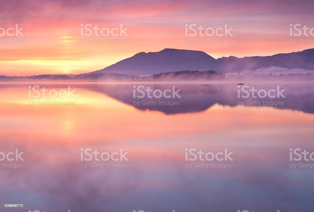 tranquil sunrise at lake forggensee in bavaria - germany stock photo