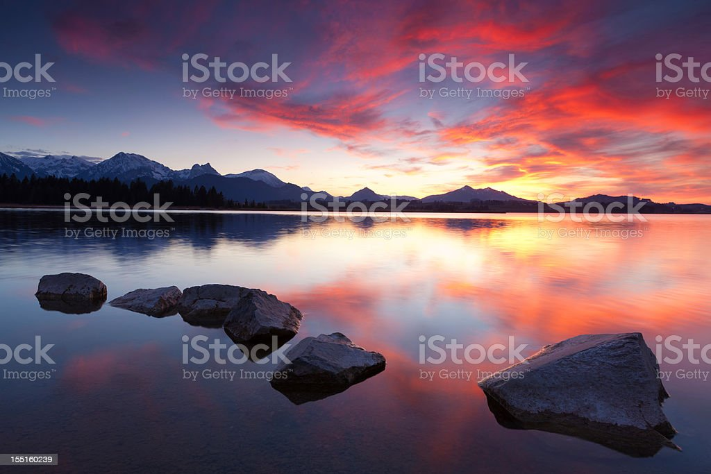 tranquil sunset at lake bannwaldsee in bavaria - germany royalty-free stock photo