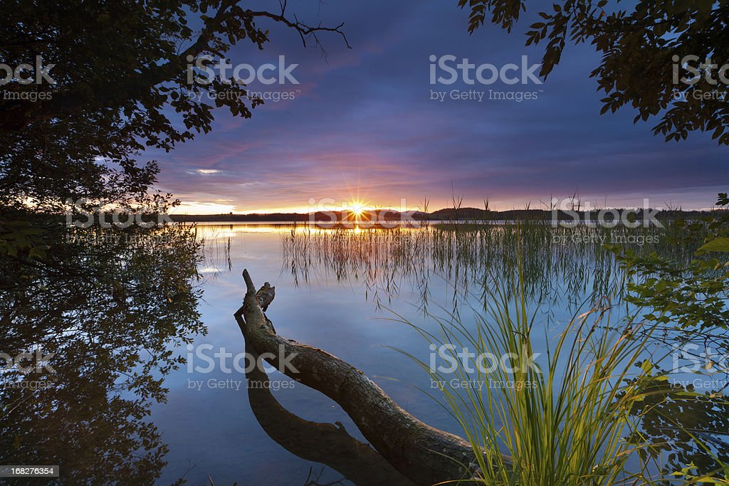 tranquil sunset at lake bannwaldsee in bavaria - germany stock photo