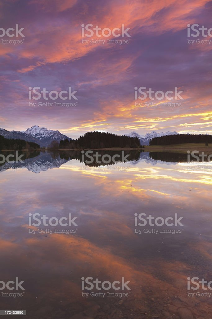 tranquil sunset at lake forggensee in bavaria - germany royalty-free stock photo