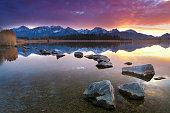 tranquil sunset at lake hopfensee, bavaria, allgaeu, germany