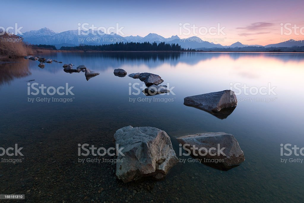 tranquil sunset at lake hopfensee in bavaria - germany stock photo