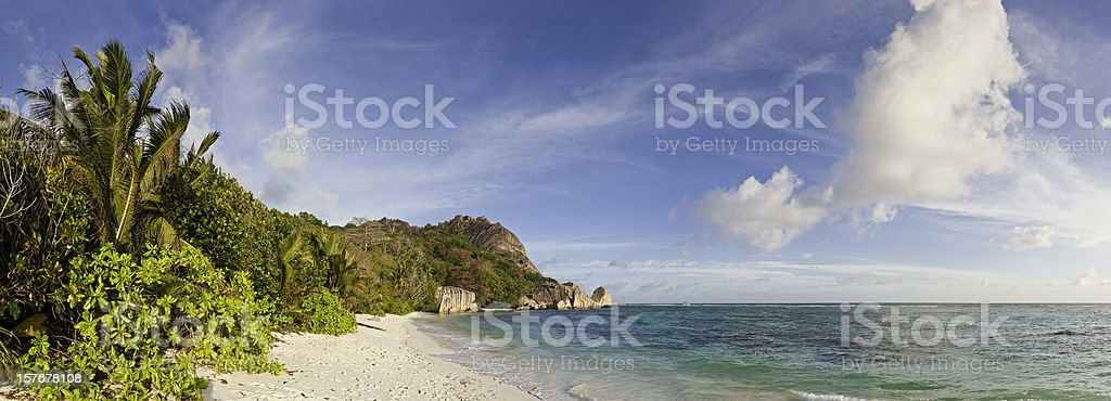 Tranquil tropical beach desert island ocean lagoon palm trees panorama royalty-free stock photo