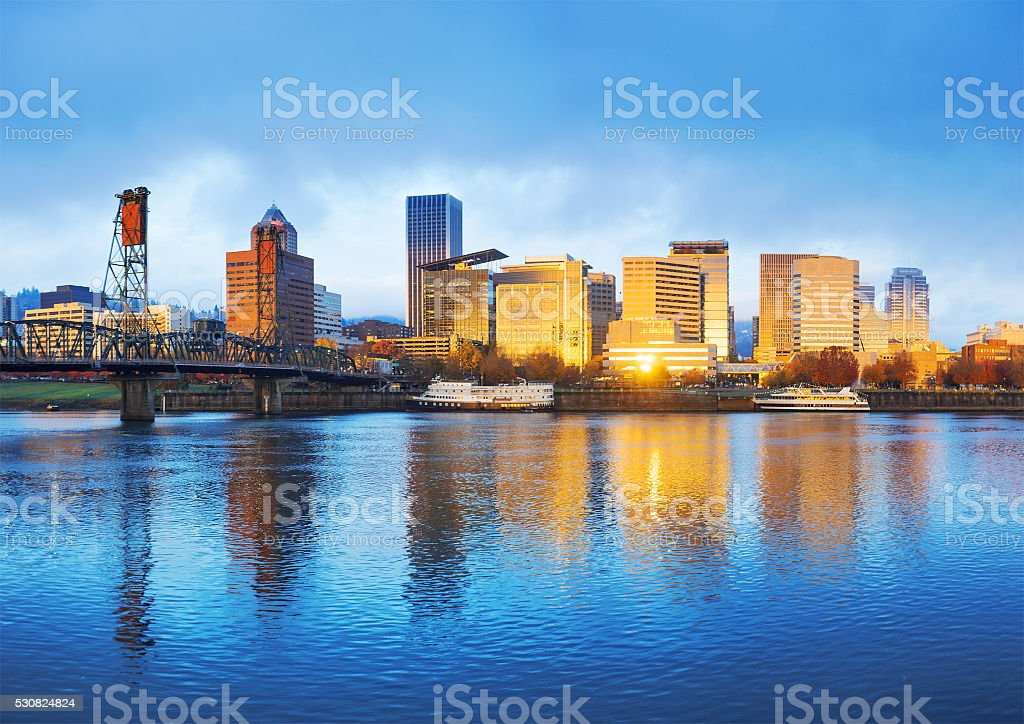 tranquil water,cityscape and skyline of portland at sunrise stock photo
