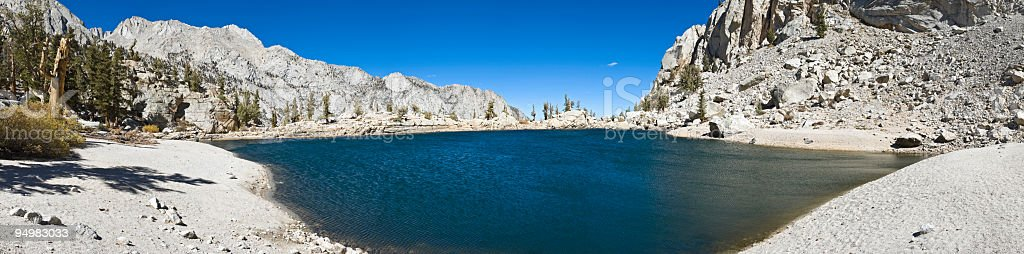 Tranquil wilderness blue lake stock photo