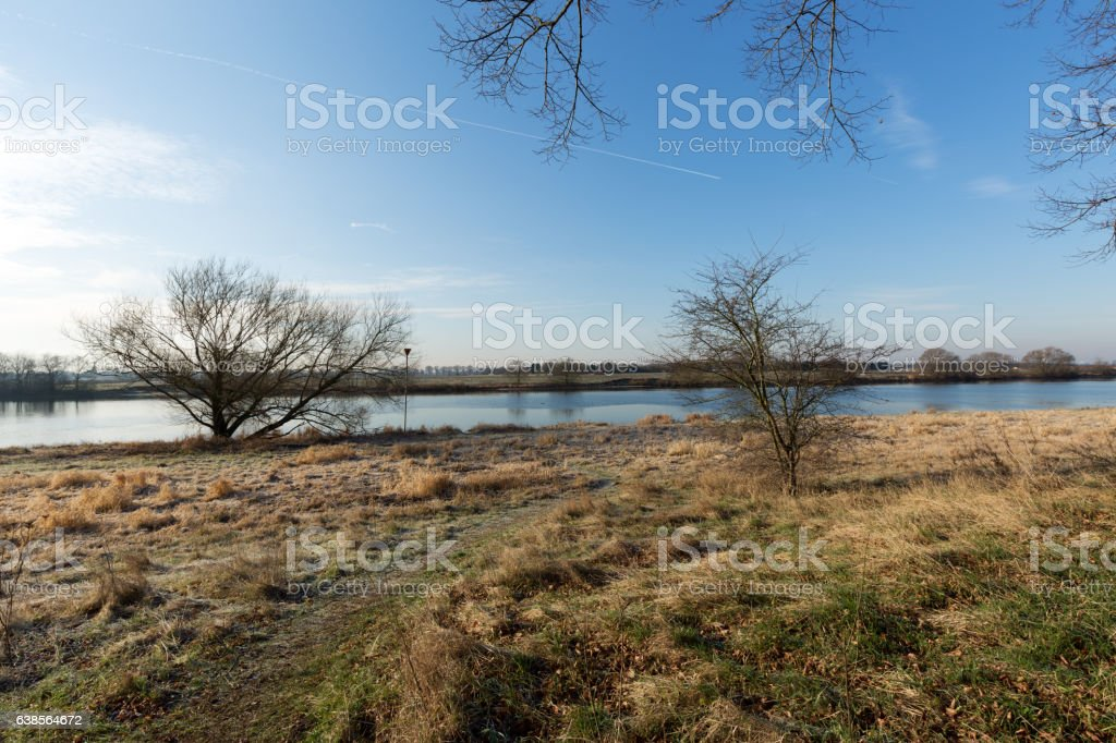 Tranquil Winter Impression at River Maas / Netherlands stock photo