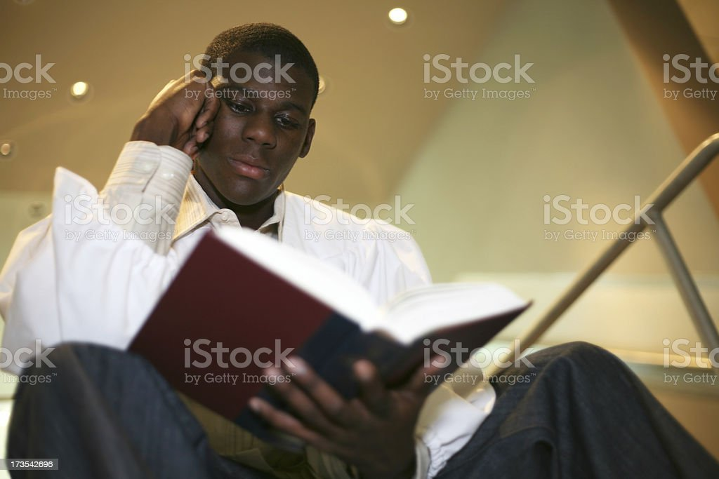 Tranquil Young Man Deep Into Reading A Book royalty-free stock photo