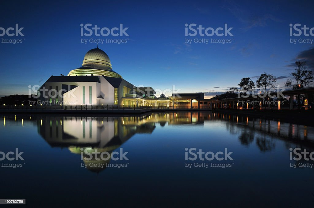 Tranquility blue hour with reflection on small lake. stock photo