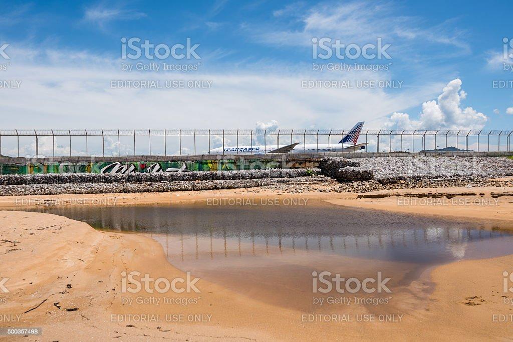 Transaero airline behind Phuket airport fence stock photo