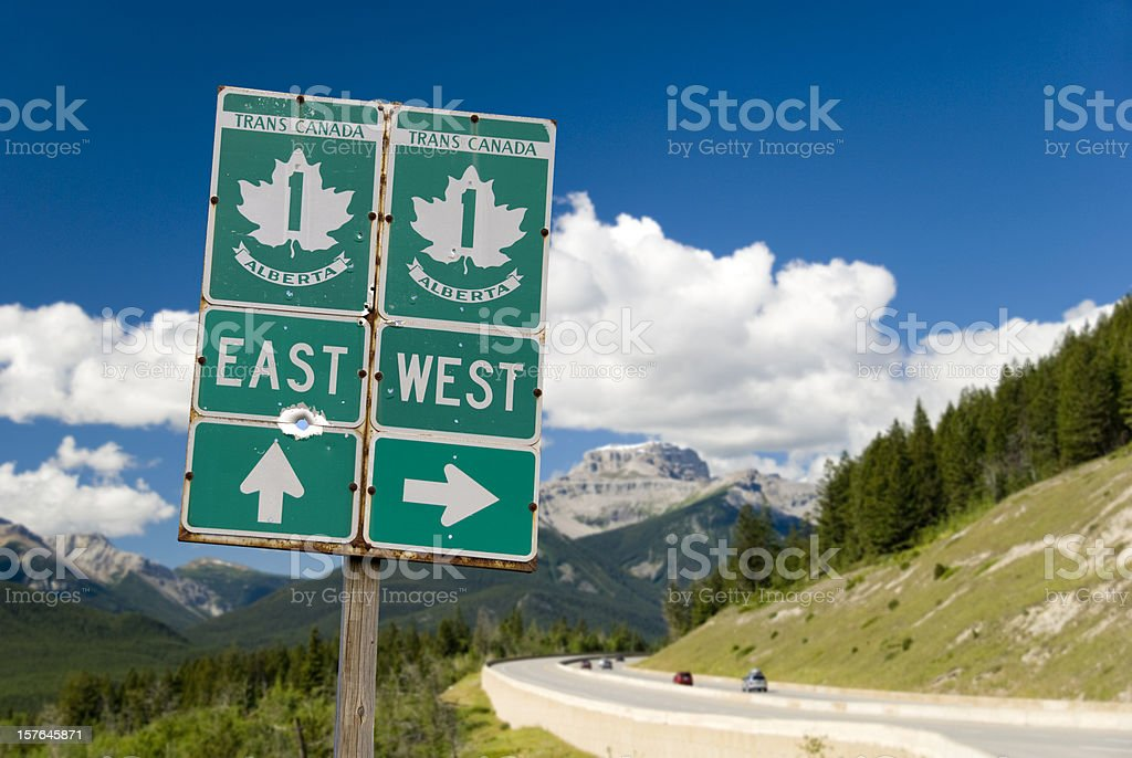Trans-Canada Highway with Roadsign through the Rocky Mountains stock photo
