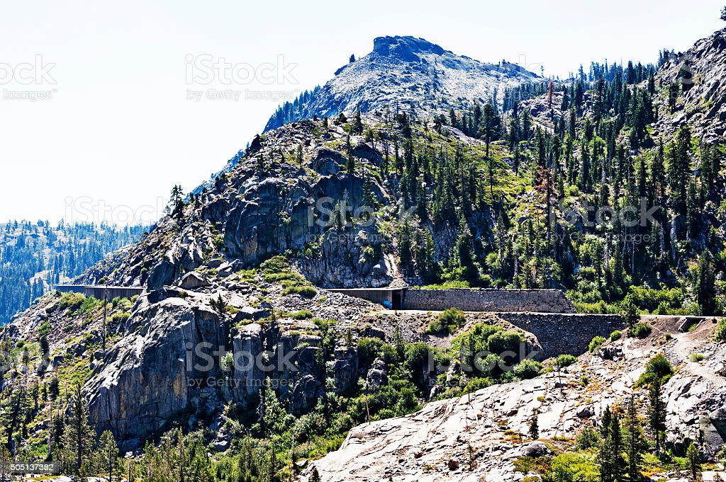 Transcontinental Railroad tracks with snow shed in Sierra Nevada Mountains stock photo