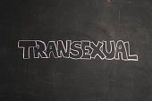 TEXT Transexual against black backdrop - Illustration