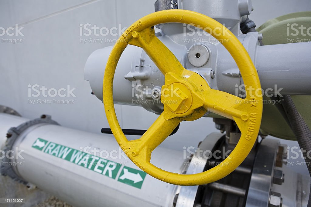 Transfer Pipe and Valve Control Wheel at Water Purification Plant royalty-free stock photo