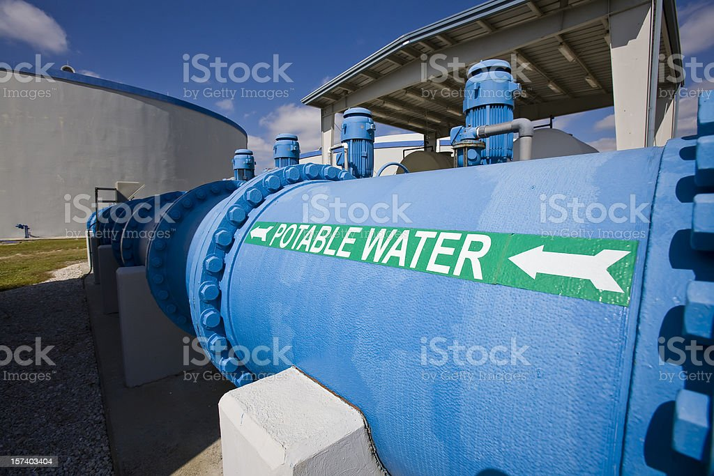 Transfer Pipe in Water Purification Plant Holding Tanks Background stock photo