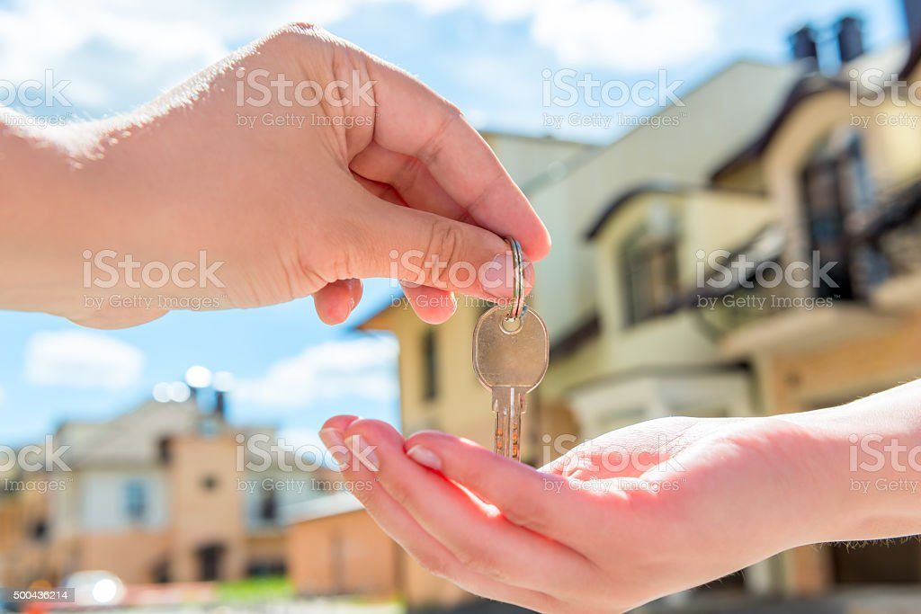 transfer to the buyer of the house key  of hands stock photo