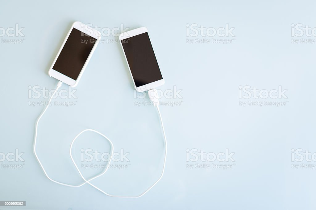 Transferring data between two USB connected smart phones stock photo