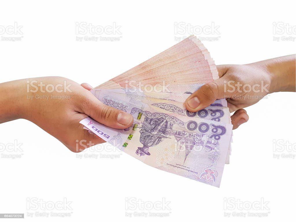 Transferring of money from hand to hand Isolated on a white background stock photo