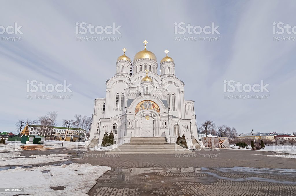 Transfiguration Cathedral with snow-covered block pavement before against sky background royalty-free stock photo