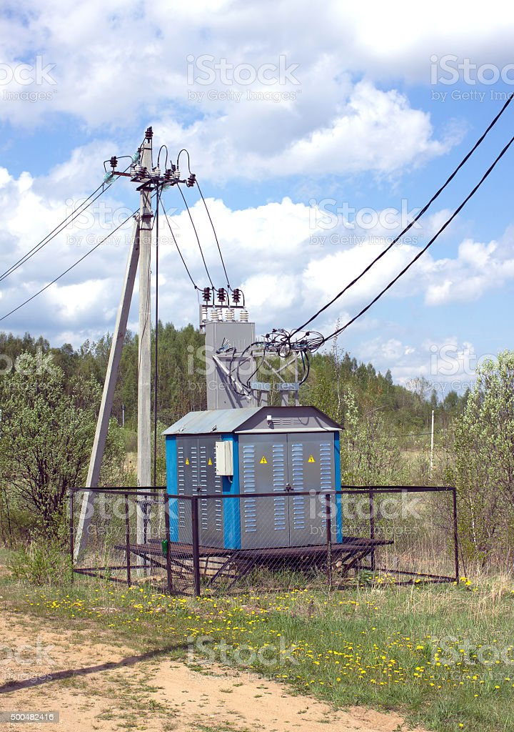 Transformer of rural power supply line in countryside stock photo