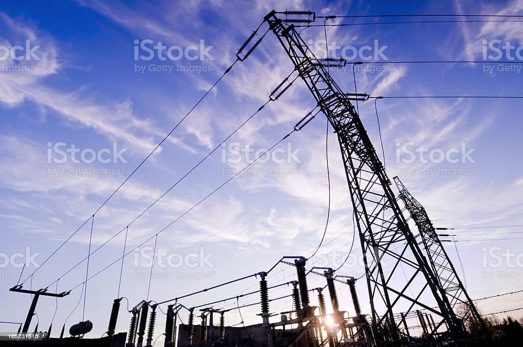 Transformer station with cloudy sky at sunset stock photo