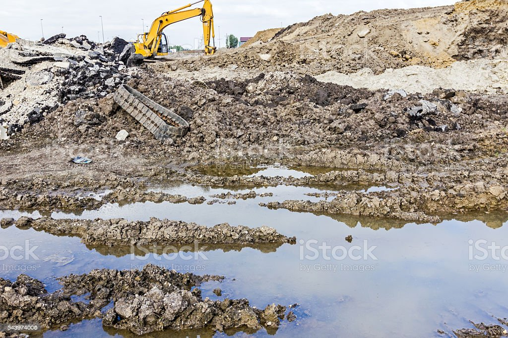 Transforming landscape into urban area, construction site stock photo