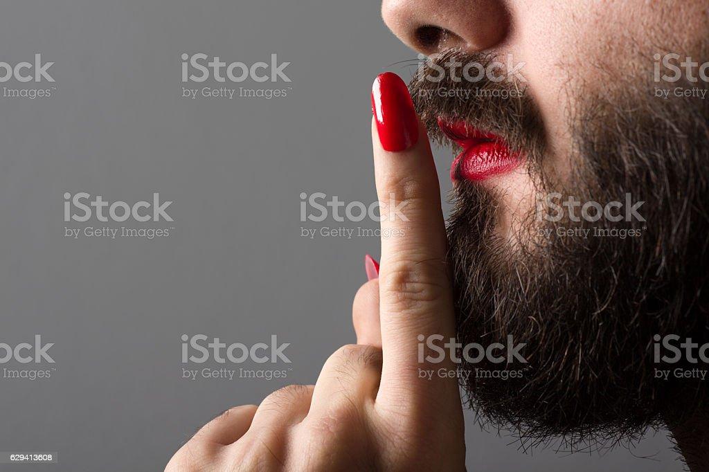 Transgender Making Silence Gesture stock photo