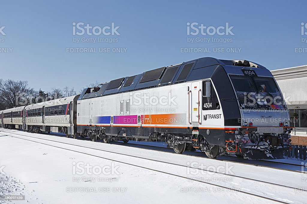NJ Transit commuter train with new loco in winter snow stock photo