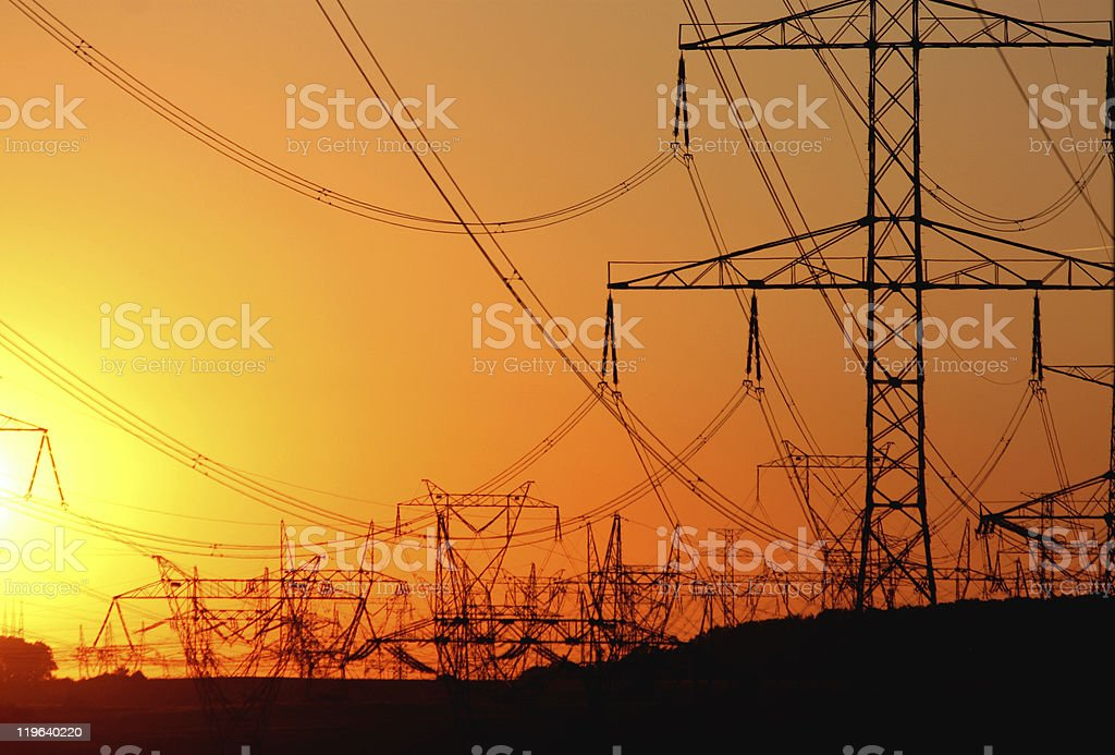 transmission tower   against the sun during sunset stock photo