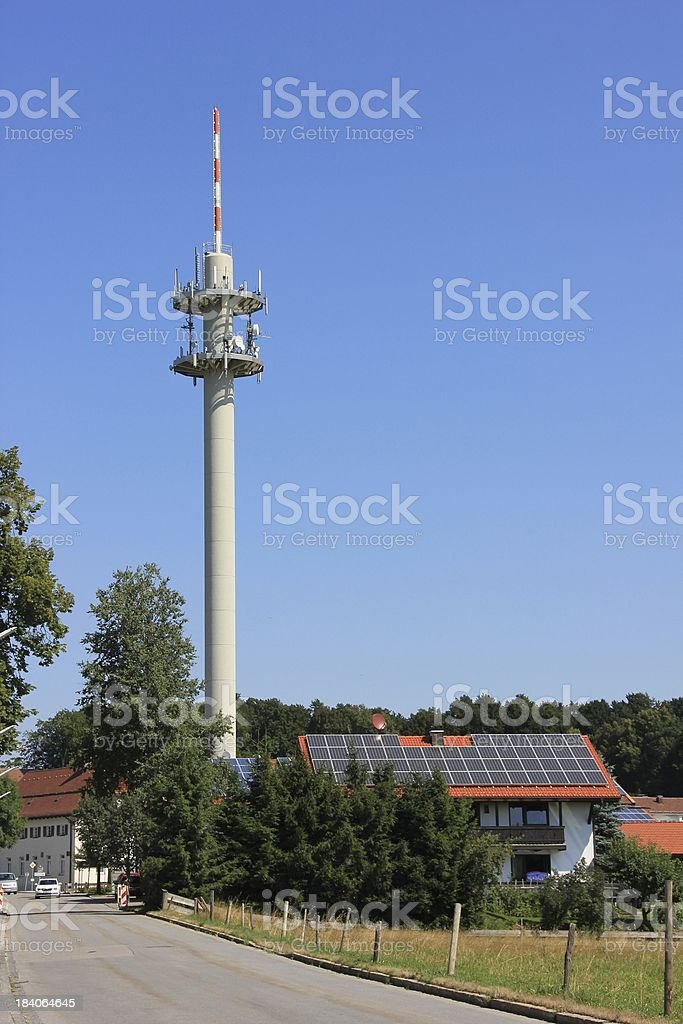Transmission tower in the village stock photo