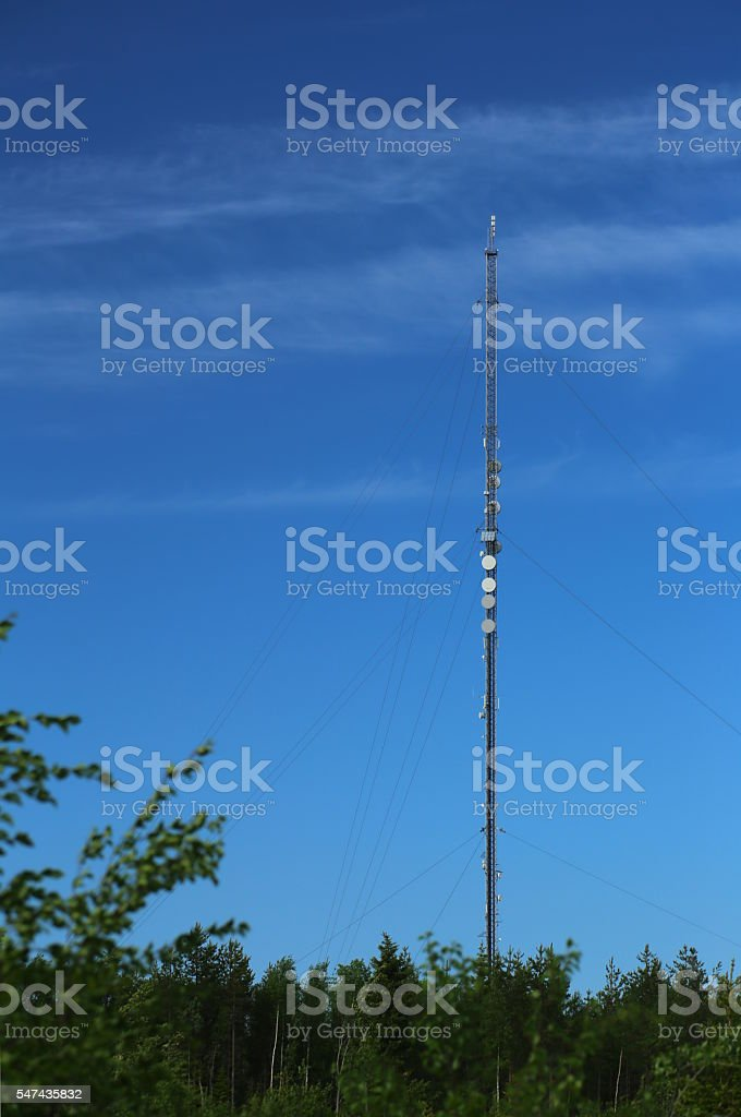 Transmitter tower in Sweden in front of blue sky stock photo