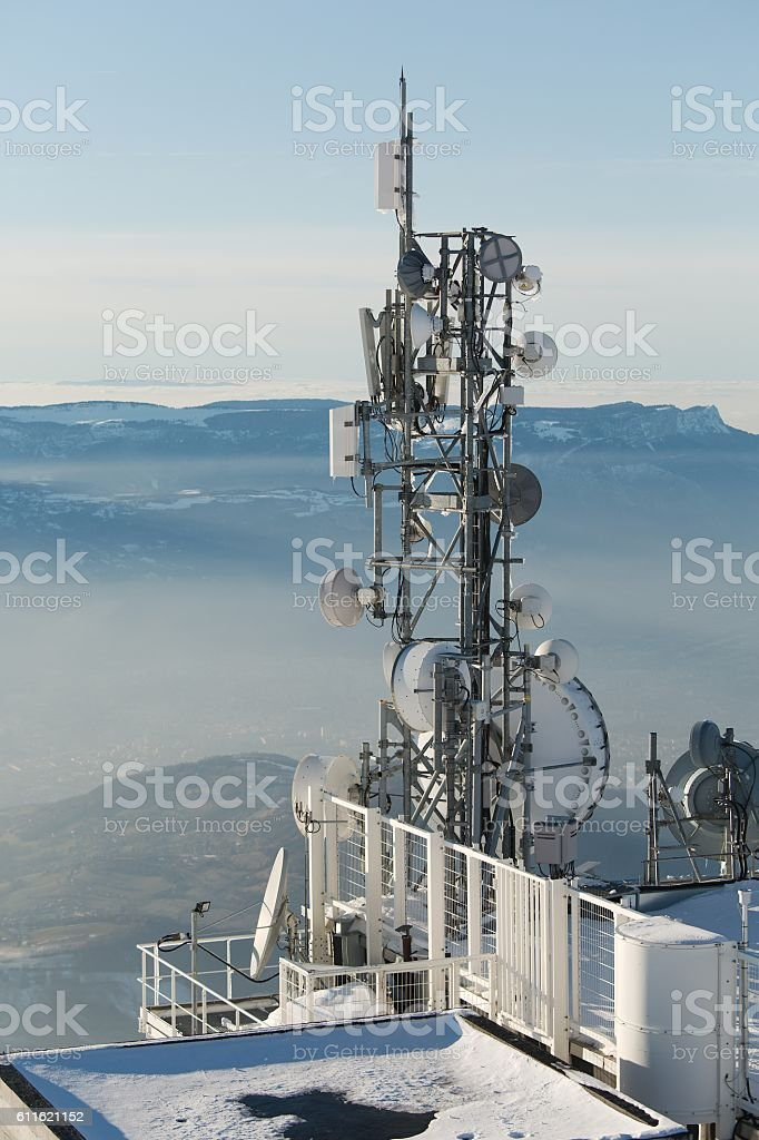 Transmitter towers on a hill in winter stock photo
