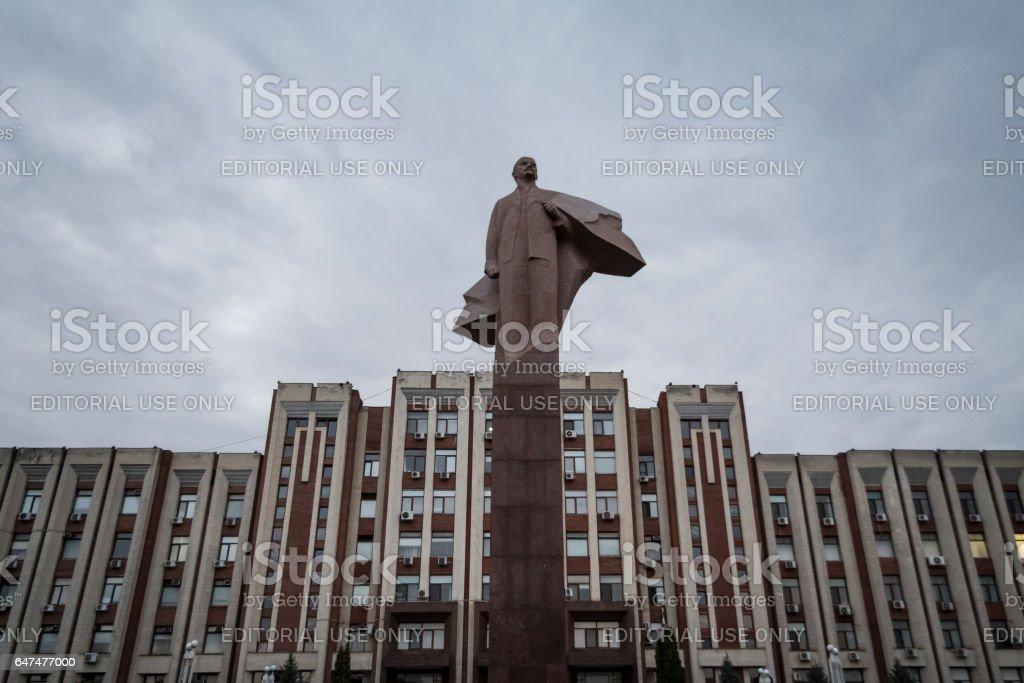 Tiraspol, Transnistria (Moldova) - August 12, 2016: Transnistria Parliament building in Tiraspol with a statue of Vladimir Lenin in front stock photo