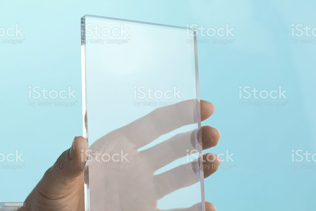 Transparent Blank Future Mini Computer Tablet Phone in Hand stock photo