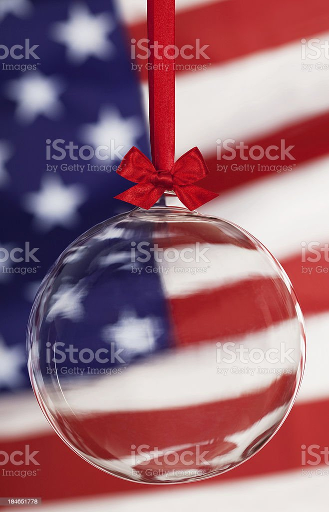 Transparent Christmas Ball Infront Of American Flag royalty-free stock photo