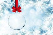 Transparent Christmas Ball Infront Of Snowflake Frame