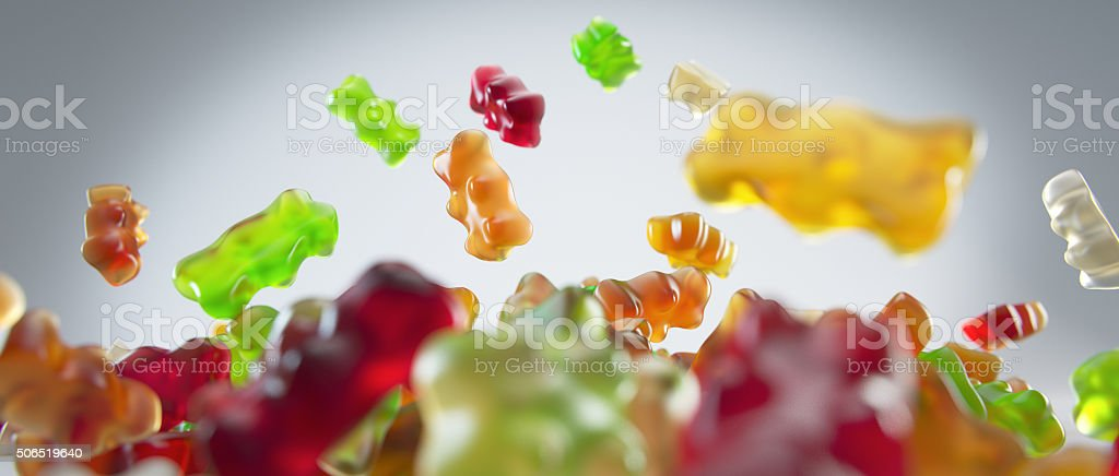 Transparent colorful sweet gummy bears falling background stock photo