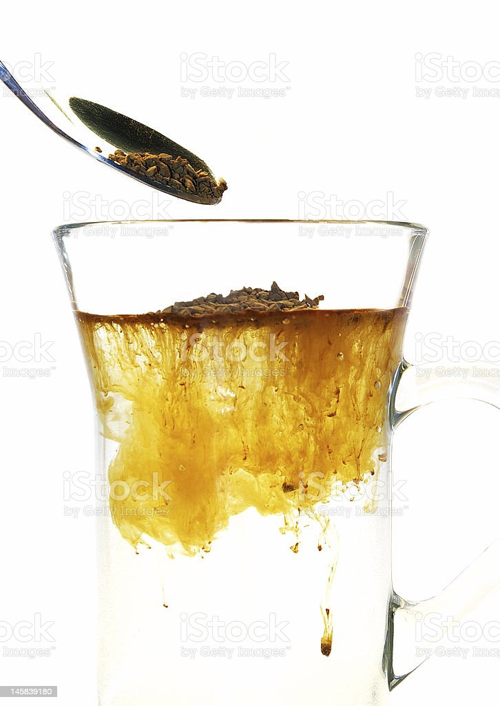 Transparent cup of an instant coffee royalty-free stock photo