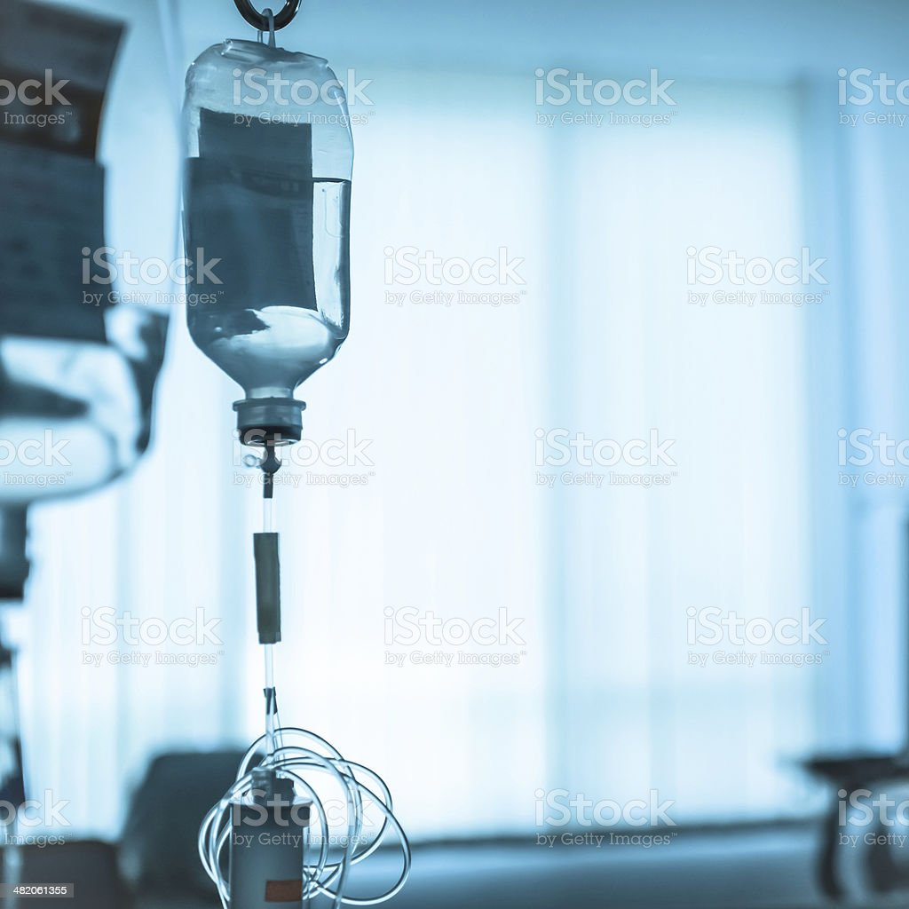 transparent drip bag and tubing process in cold tone stock photo