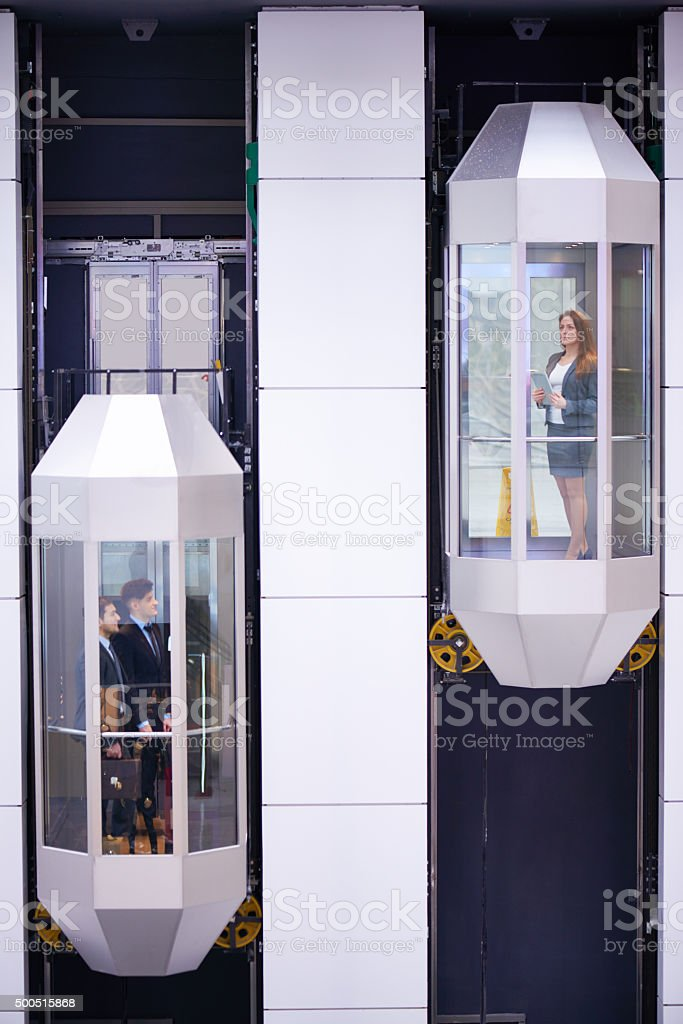 Transparent elevators stock photo