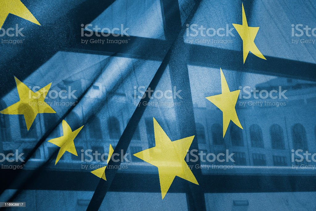 A transparent European Union flag obscures partly a building royalty-free stock photo