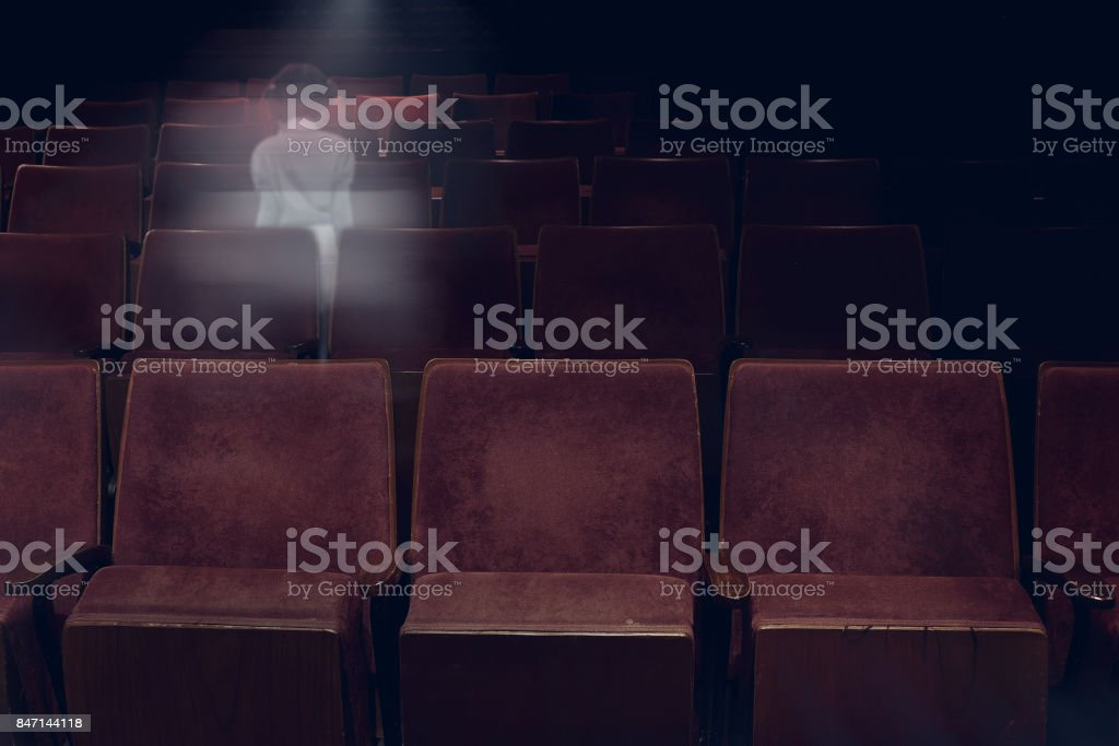 transparent ghost little girl appears between vintage seat in movie...